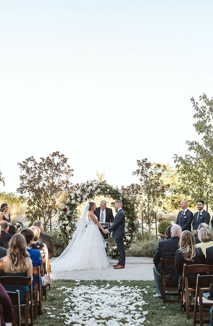 Elegant Wine Country Wedding Ceremony with a Round Backdrop