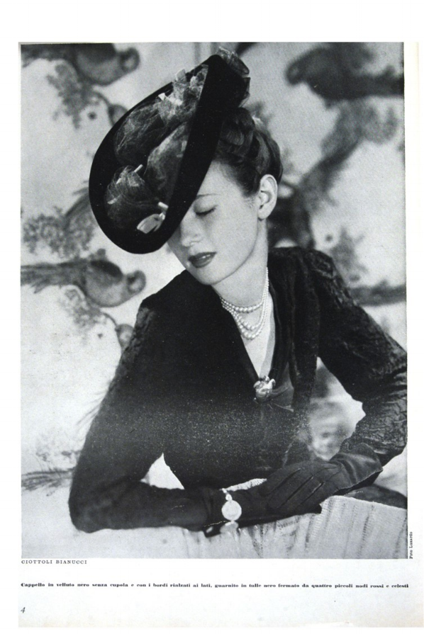 Black velvet hat, tulle trimming held in place by red and light blue knots. From Bellezza, September, 1942. Biblioteca nazionale, Rome.