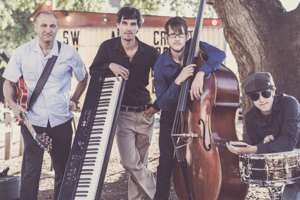 Left to Right:    Chad Spivey (Upright Bass),   Doug Anthony (Guitar), Benito Brajkovich (Piano), Aaron Parks   (Drums)