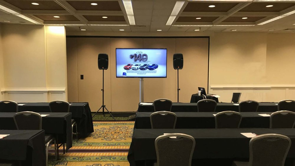 Projections Screens, Pipe and Drape and Up Lighting Rented, Setup & Operated by Visual Advantage at a Downtown Tampa Hotel
