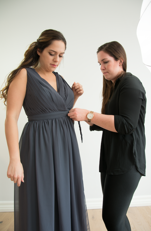 Mallory showing our model how simple and easy our wrap dress is!