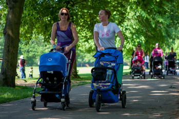 Two mums pushing buggies at Buggyfit, Ealing