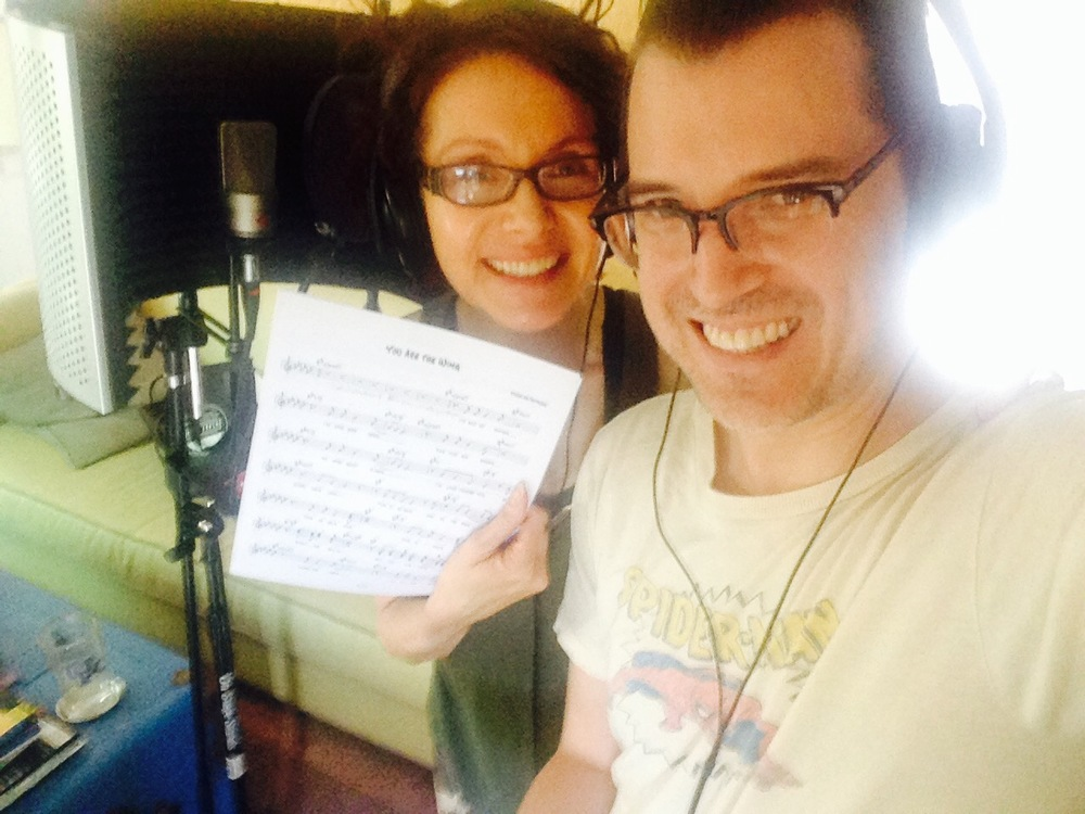 Maura and Scott record vocals for INSULT TO INJURY