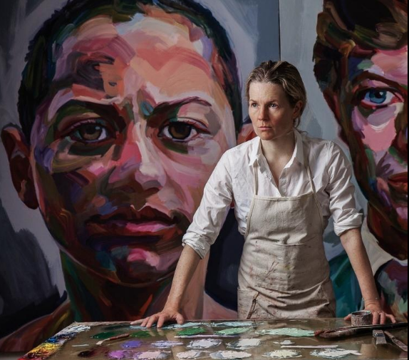"Jo Hay at work in her studio before her portrait of Emma Gonzalez, part of ""The Persisters"" exhibit (Photo: Ron Amato)"