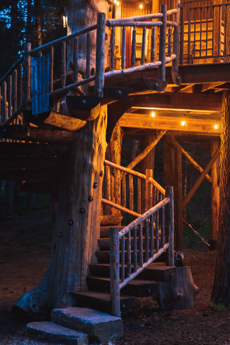 The custom hand crafted spiral staircase leading up to the Montana Treehouse Retreat sets the grand entrance for the property.