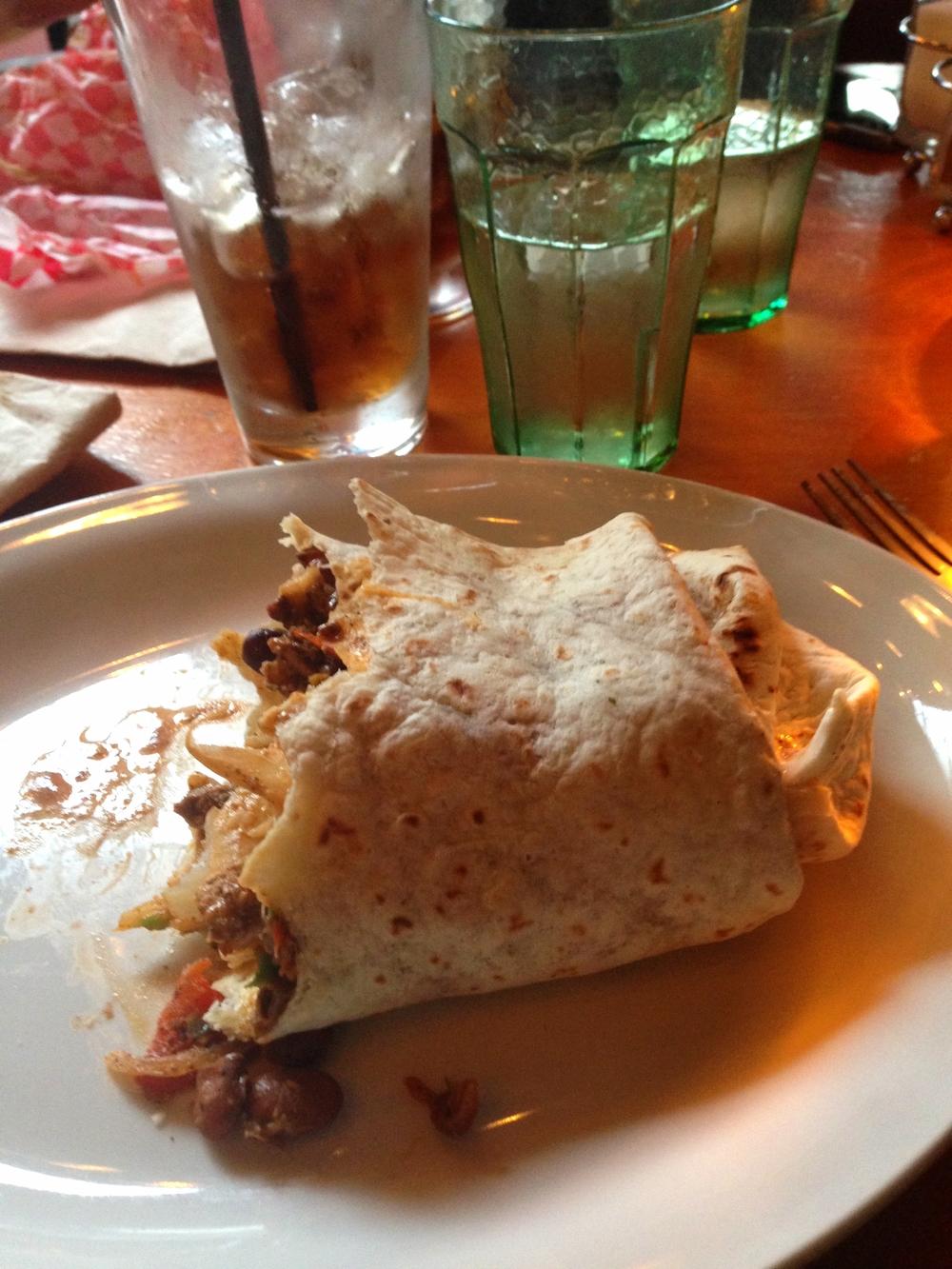 Half eaten fajita burrito