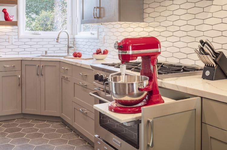 An appliance lift provides a handy storage solution for much-used & heavy kitchen appliances.