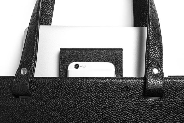 A 3-USB power bank wrapped in Italian leather is included with every bag.  Pictured here is the #VerticalTote by #SubspaceDesign