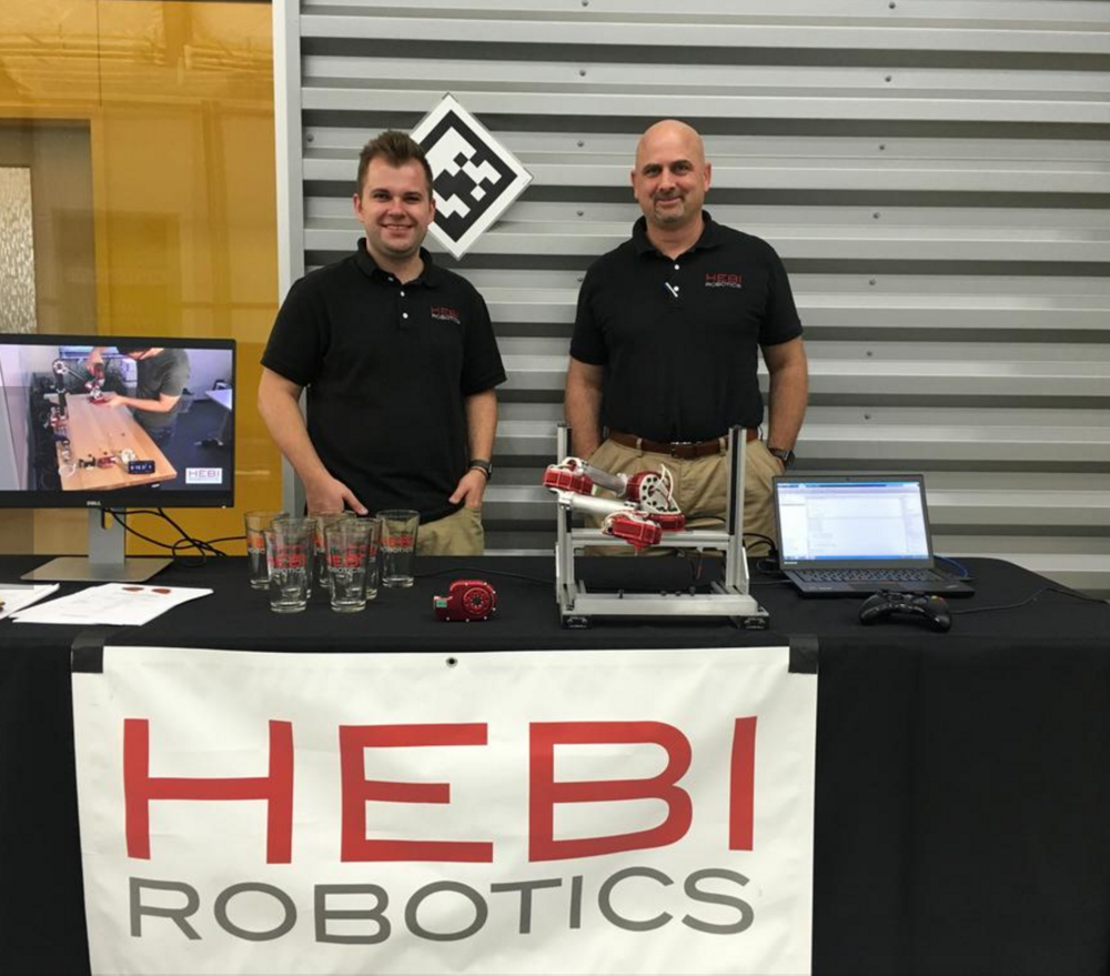 HEBI Robotics engineer Alex Schepelmann and Business Developer Bob Raida with a demonstration of HEBI's modular joints, perfect for rapid developing and building robotic arms.