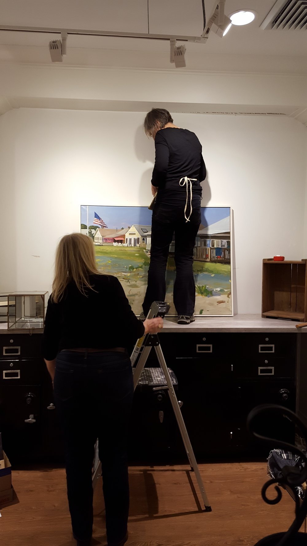 Lois Reboli, Pam Brown, and Cathy Haenlein working on changing the exhibit.