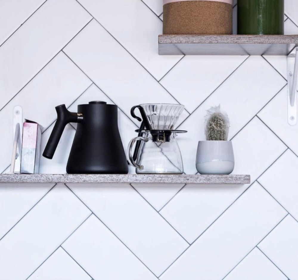 We did an epic herringbone tiled wall Fika On Brix  cafe choosing a light grey grout to give it a bit of definition.