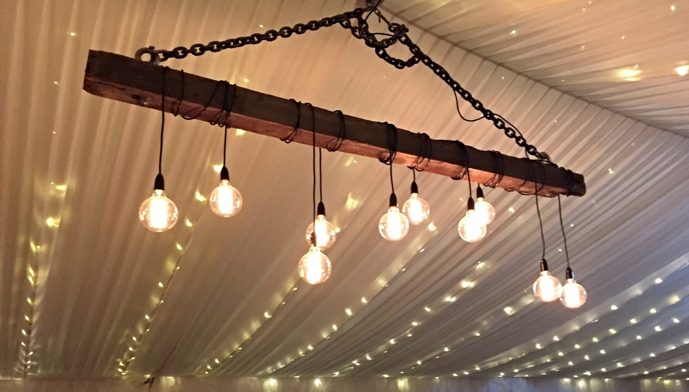 Our custom made beam lights installed in one of our silk lined marquees with an additional