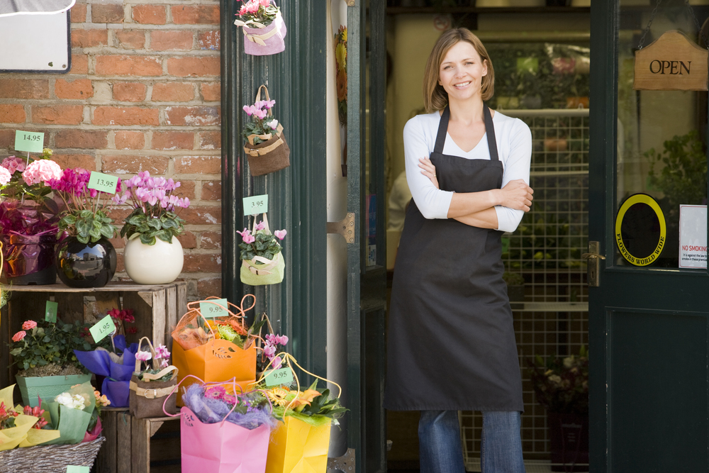 bigstock-Woman-Working-At-Flower-Shop-S-4136224.jpg