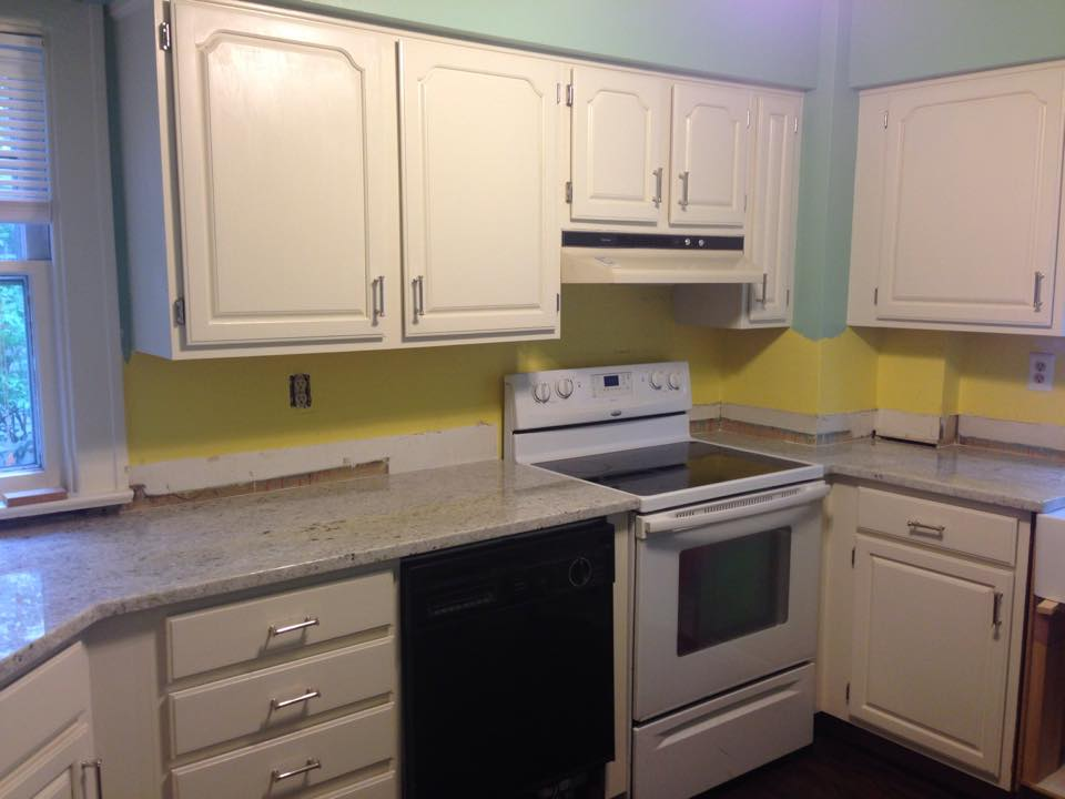 Change comes in shades of yellow! Finished paint and counters, but no back splash to cover the clashing wall strip!