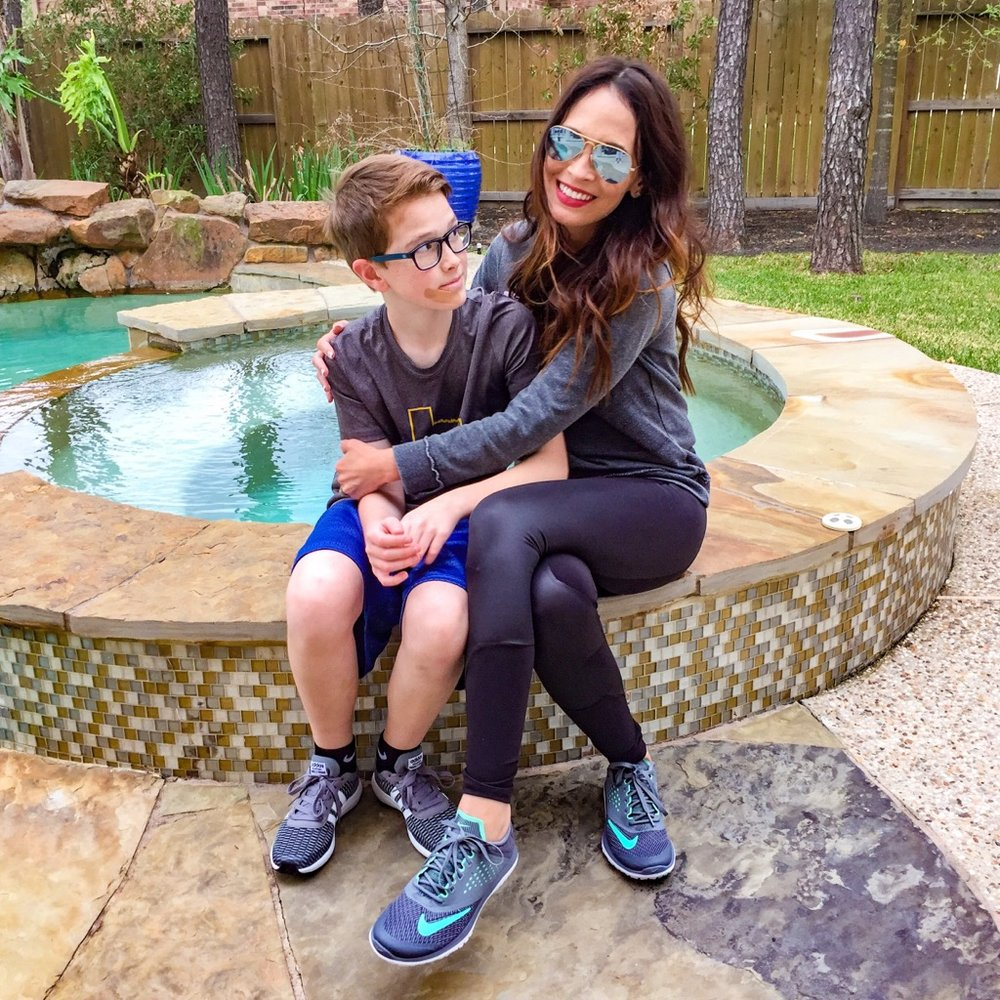 My son only took a pic with me because I bought him a new pair of shoes! :) I'm loving the leather like details in these leggings. They're cute enough to wear outside the gym! Shop these leggings by clicking on the pic above!