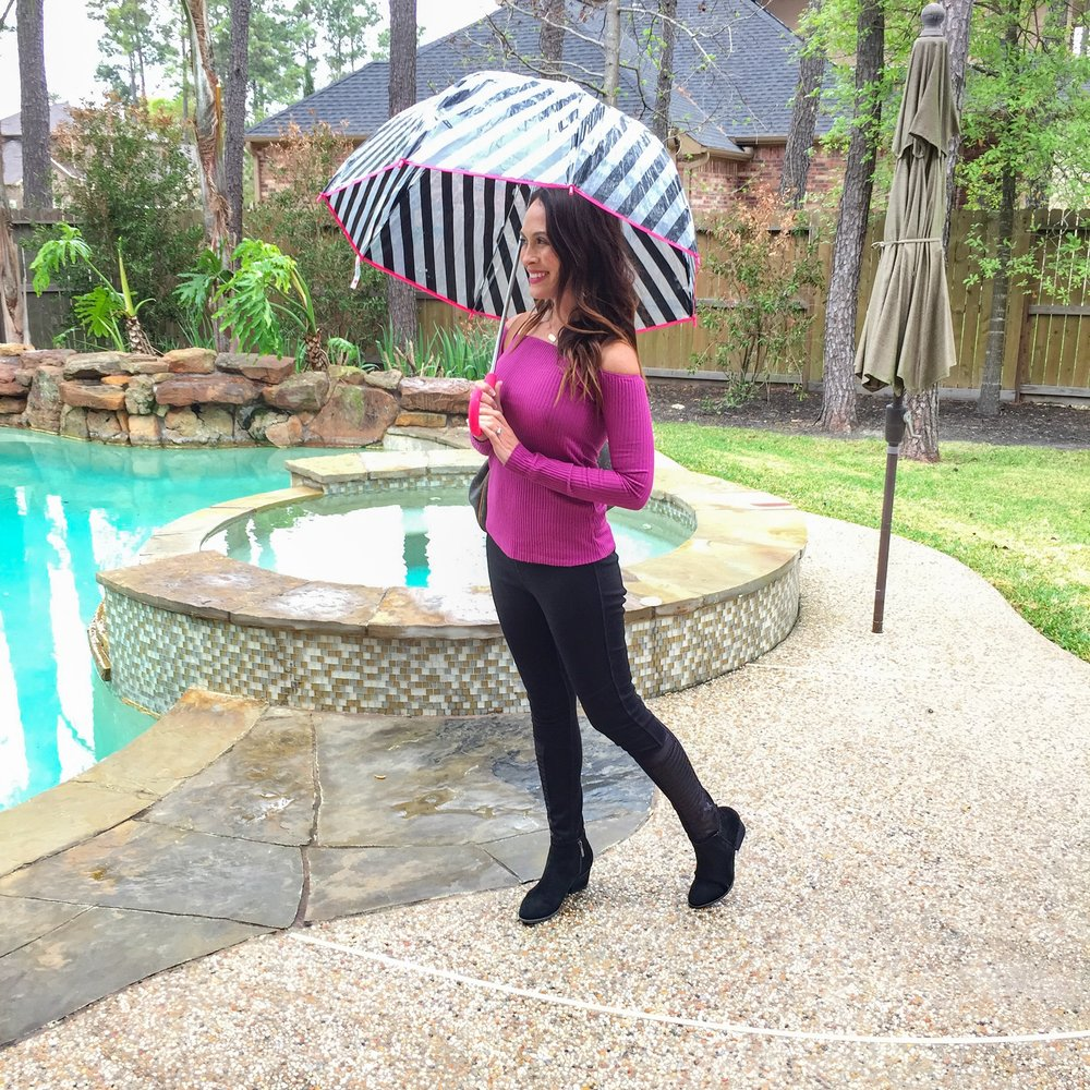 Staying dry with this cute umbrella! Shop this umbrella from Kate Spade by clicking on the pic above!