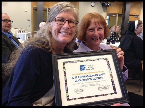 Darla & Donna receiving Vision Action Network Cameron Award on behalf of Just Compassion.