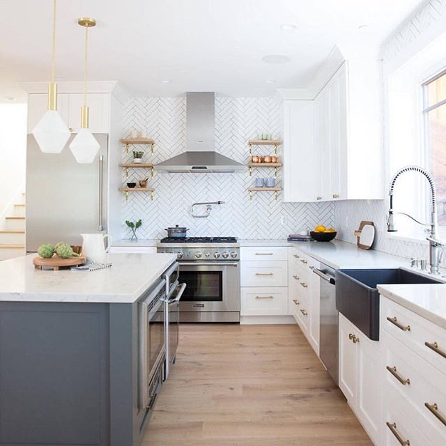 What's your favorite part of this kitchen? I love the light fixtures and soft brass cabinet handles.