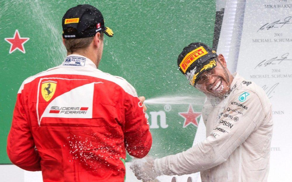 100498549_Mercedes_driver_Lewis_Hamilton_right_of_Britain_is_sprayed_by_second-placed_Ferrari_dr-xlarge_trans++eo_i_u9APj8RuoebjoAHt0k9u7HhRJvuo-ZLenGRumA.jpg
