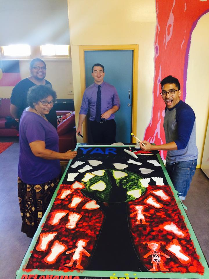 2016 January 20th Our Team painting with Aunty Kathryn preparing the Murals for our YARN Story Telling Workshop at YABUN FESTIVAL. Above: Aunty Kathryn Dodd Farawell, Warren Roberts YARN Founder, Patrick Gallego YARN Research Director, Chris Rodrigo YARN Volunteers Coordinator.