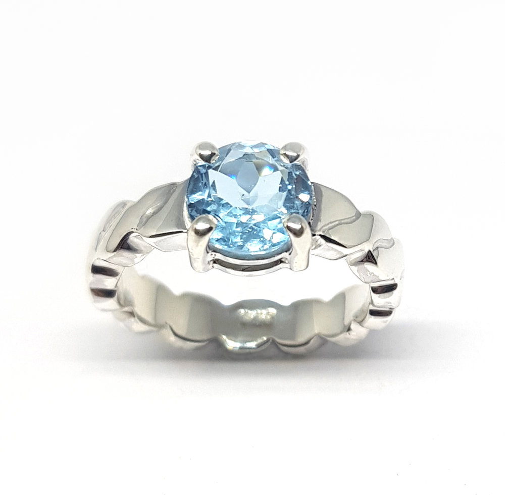 Topaz and silver ring