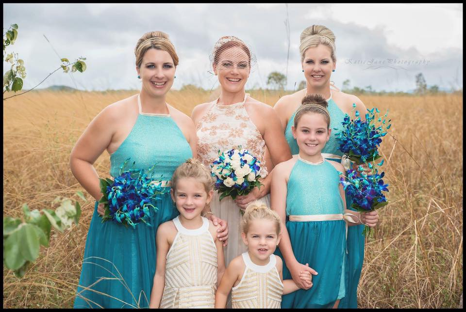 Marissa and her bridal party looking amazing on her special day!   Photo courtesy Katie Jane Photography
