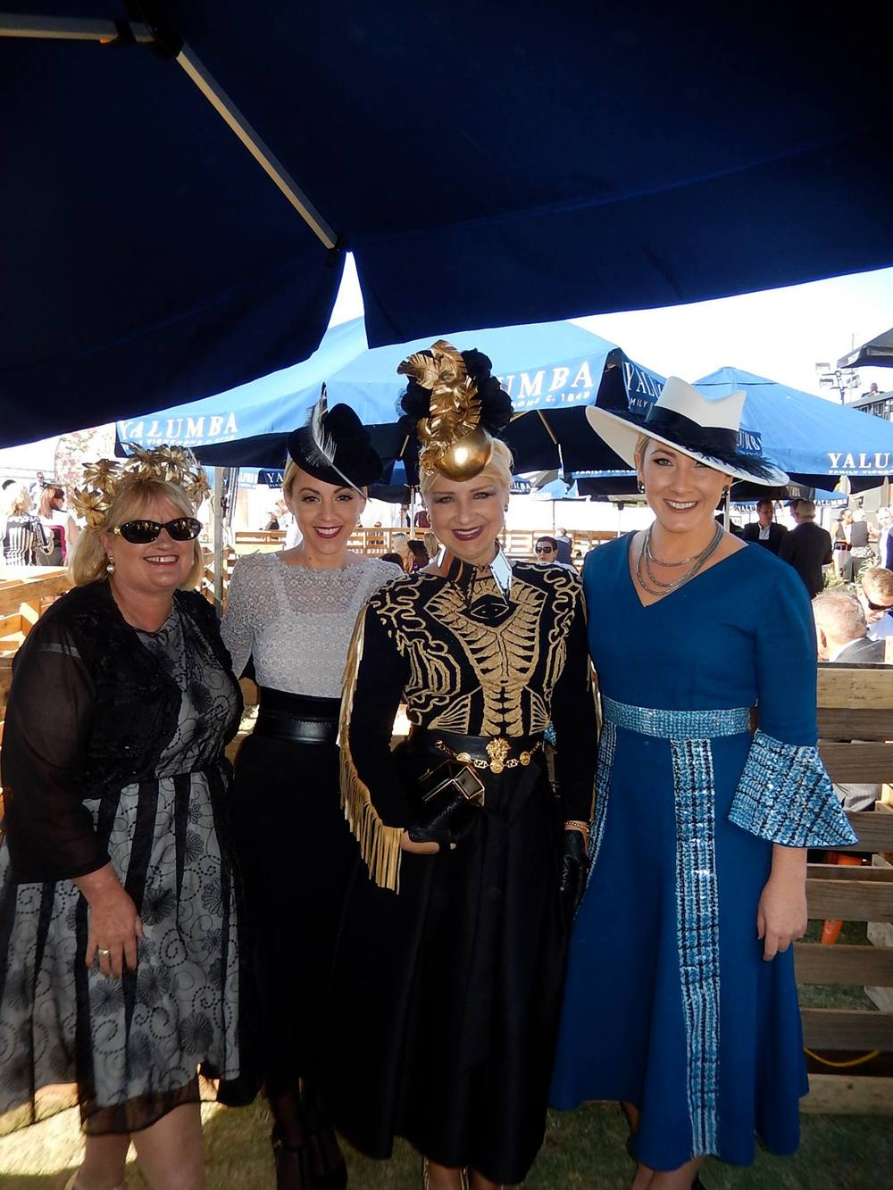 Spending so much time at the track you naturally form some wonderful friendships with fellow fashions on the field friends - Caren, Marla & Alla.   Image by Alla Demich