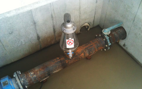 ARI D-023 combination air-release and vacuum air valve on wastewater transfer line in Alberta.