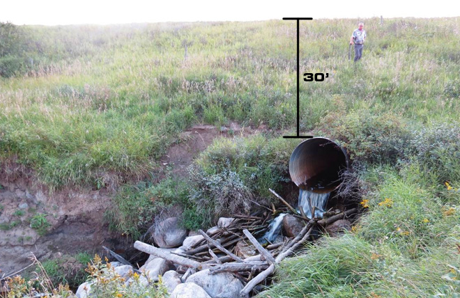 Photo: deteriorating culvert in Saskatchewan where the municipality can use Centri-Pipe to reline the pipe instead of digging up the road and replacing the culvert. In this location, there is 30 vertical feet of soil above the culvert pipe and it is not feasible to dig and replace. APM Centri-Pipe is the best option to save this culvert.