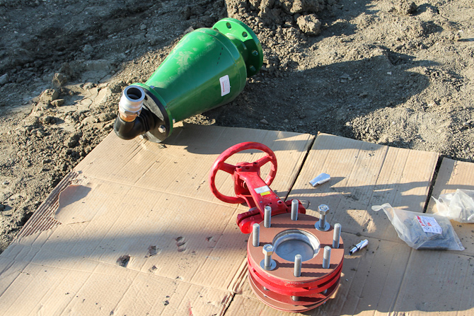 A.R.I. D-020 air valve (green) and isolation valve ready to be lowered into manhole chamber.