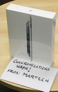 Wayne Donald wins new Apple iPad 2 in the Versa-Max Fastest Clamp Contest at AWWOA.