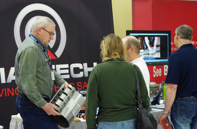 Martech's Don Anderson demonstrates the TPS Ez-Max pipe repair clamp for trade show attendees.