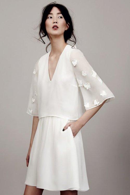 Quelle coiffure associer à une robe de mariée courte ?