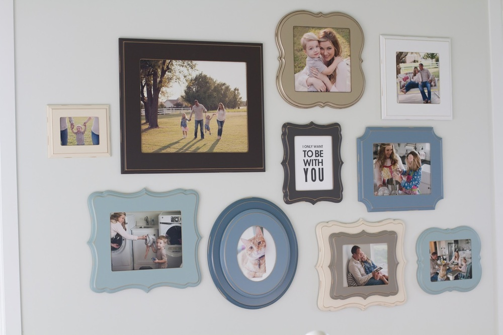Love the neutrals in this family wall...