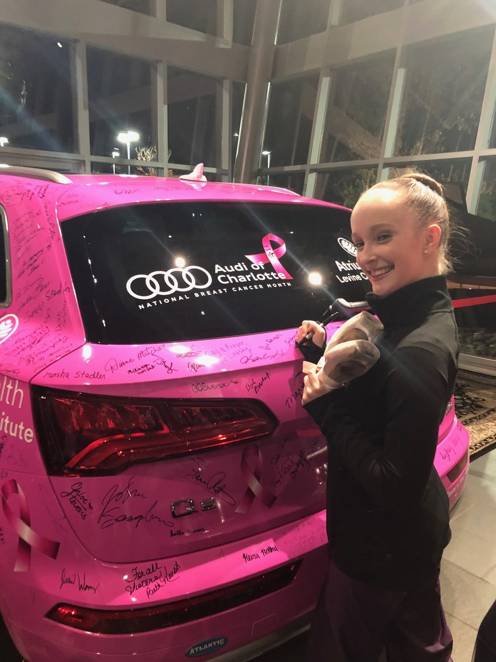 Signing to up Audi Charlotte's donation to GoJenGo, fighting breast cancer