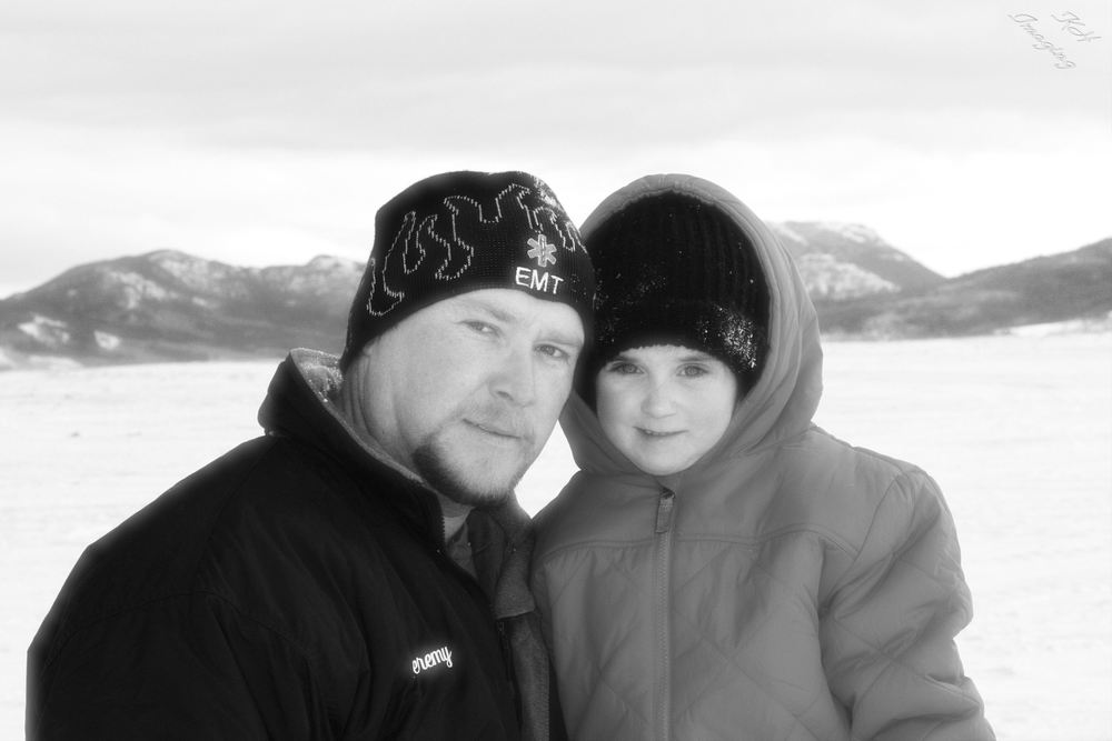 This image isn't that bad. The editing is wrong (for my current style anyway) but it is cute, a father daughter moment. Walden, CO Dec. 2008