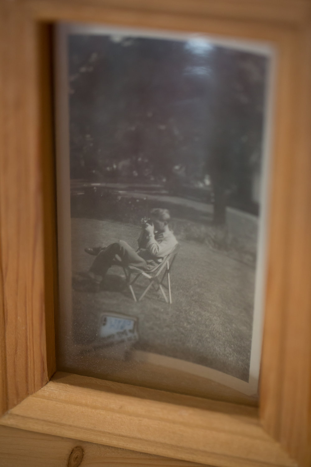 This photograph of my grandpa sits next to his camera that I now have.