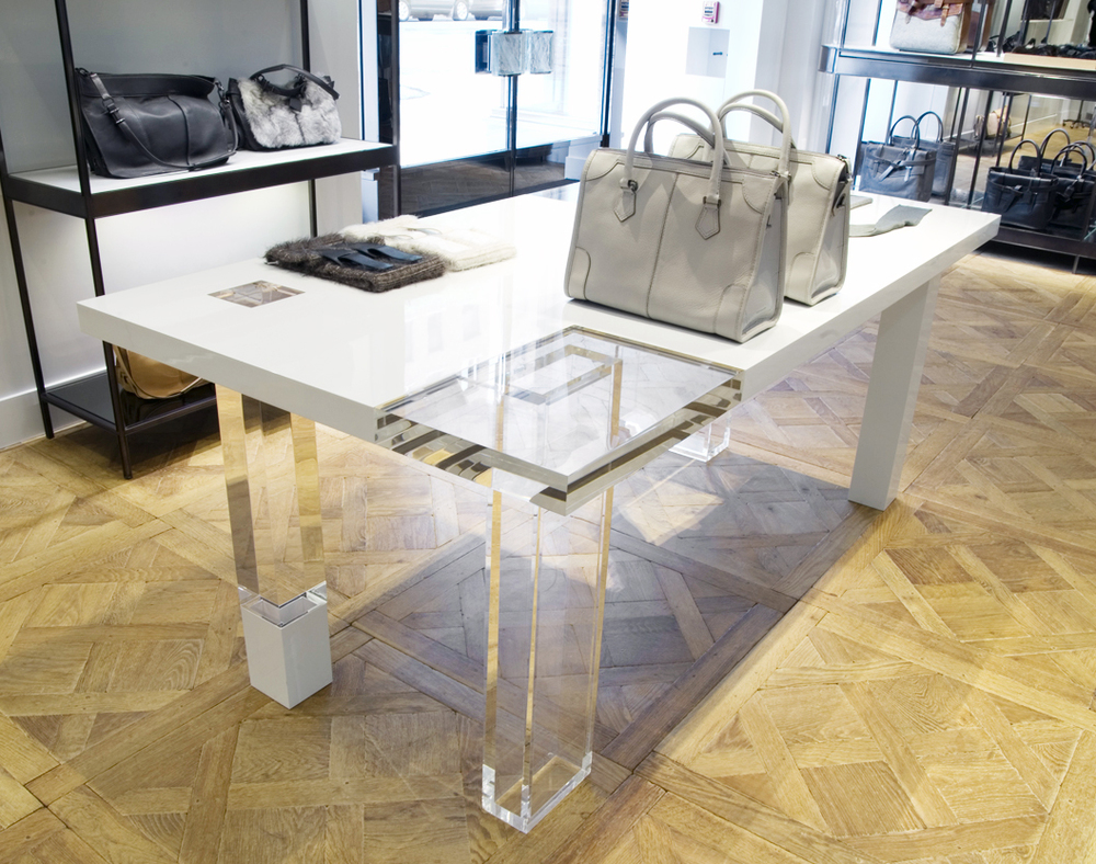 Reed Krakoff table with clear leg.jpg