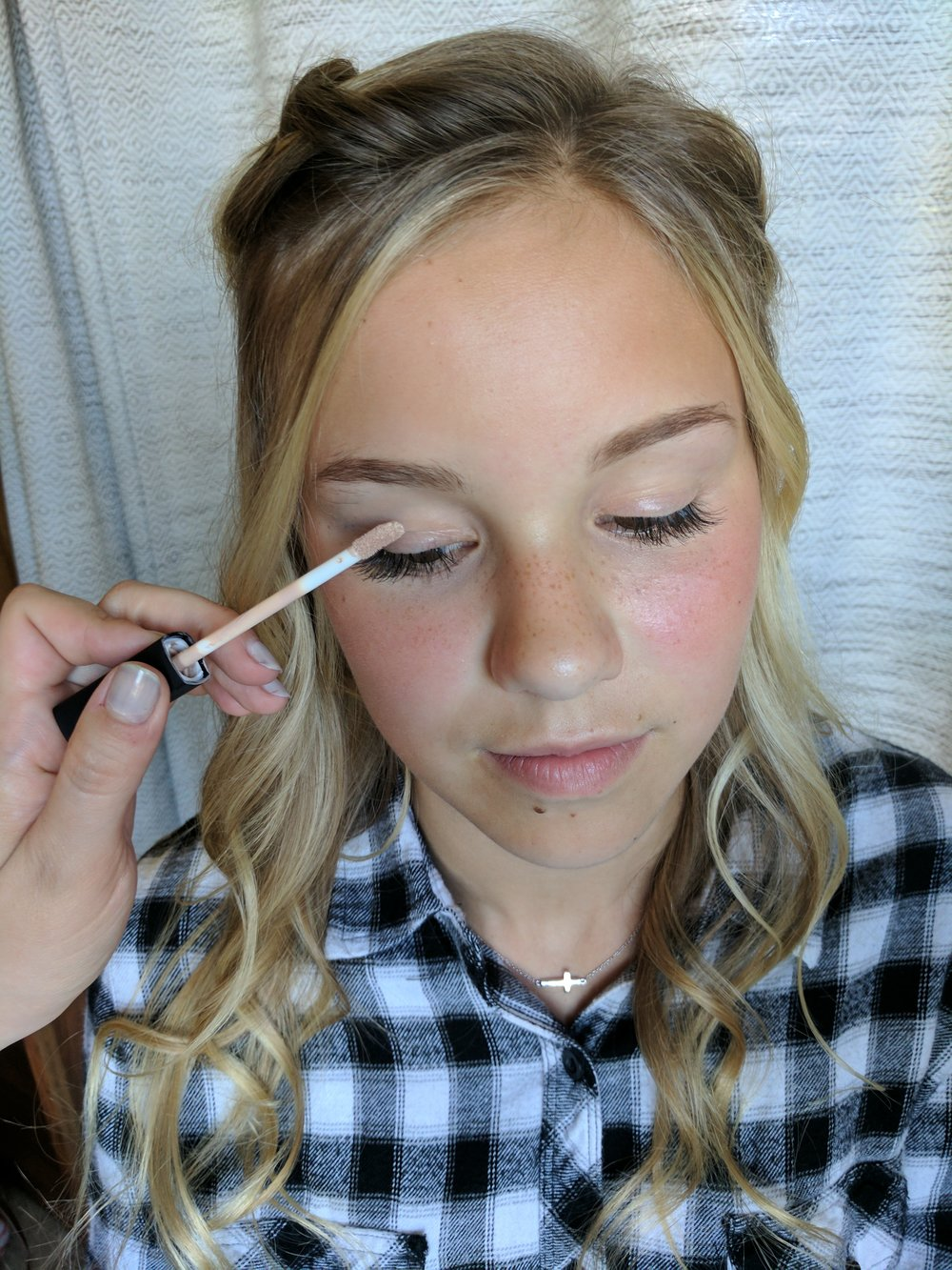 Step 2:  - Dab a little concealer onto the lids of your eyes to brighten and even your natural skin tone.