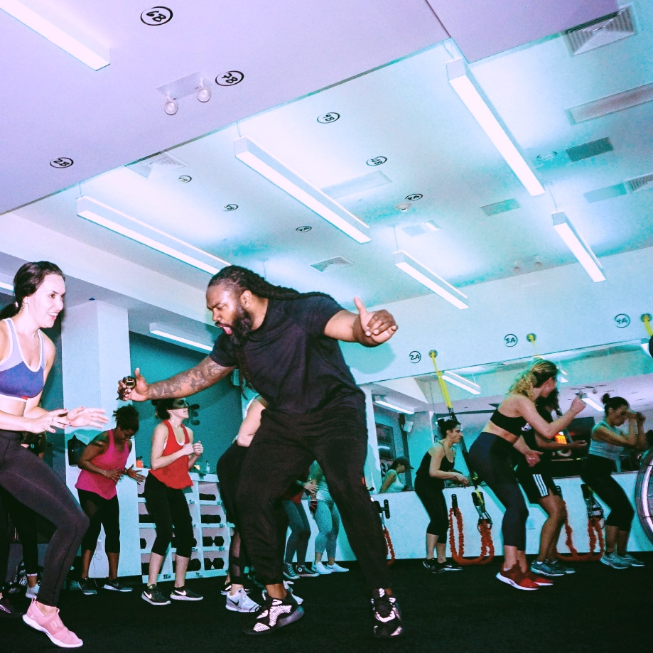 Pack Leaders   Corey Harbison   &   Kris Alicea   maintain a high energy throughout each 1 hour class at BEAST: Fitness Evolved