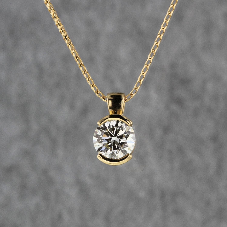 1 50ct Diamond In Yellow Gold Half Bezel Pendant Kizer Cummings Jewelers