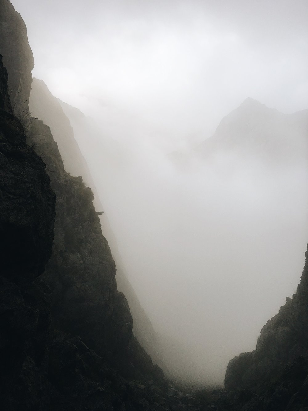 Last Col of the day and a cheeky scramble down in the mist.