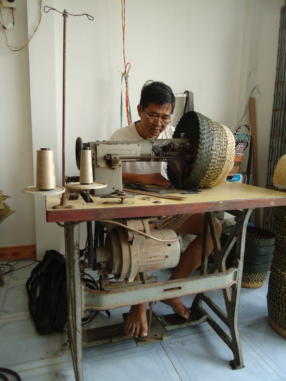 Phuoc at work sewing