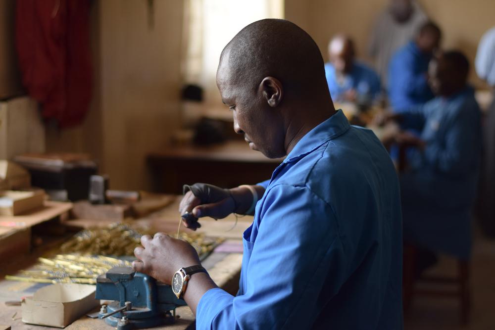 Artisan Joachim working on Serrv bracelets at Trinity Jewellery Crafts