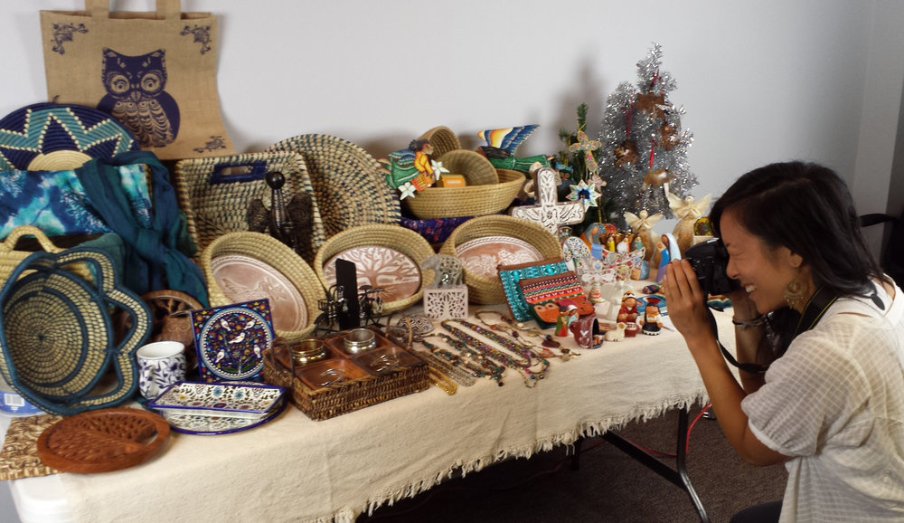 Esther, Serrv's graphic designer snaps a photo of a Holiday Consignment Package