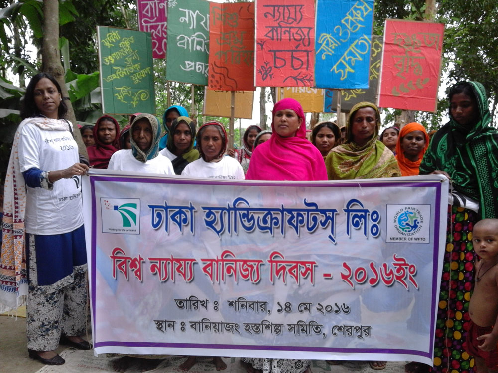 Tanu Dey, left, with women artisans marching for World Fair Trade Day