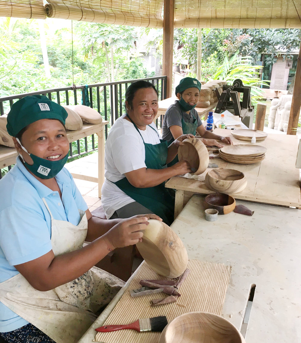 Artisans finishing wooden bowls