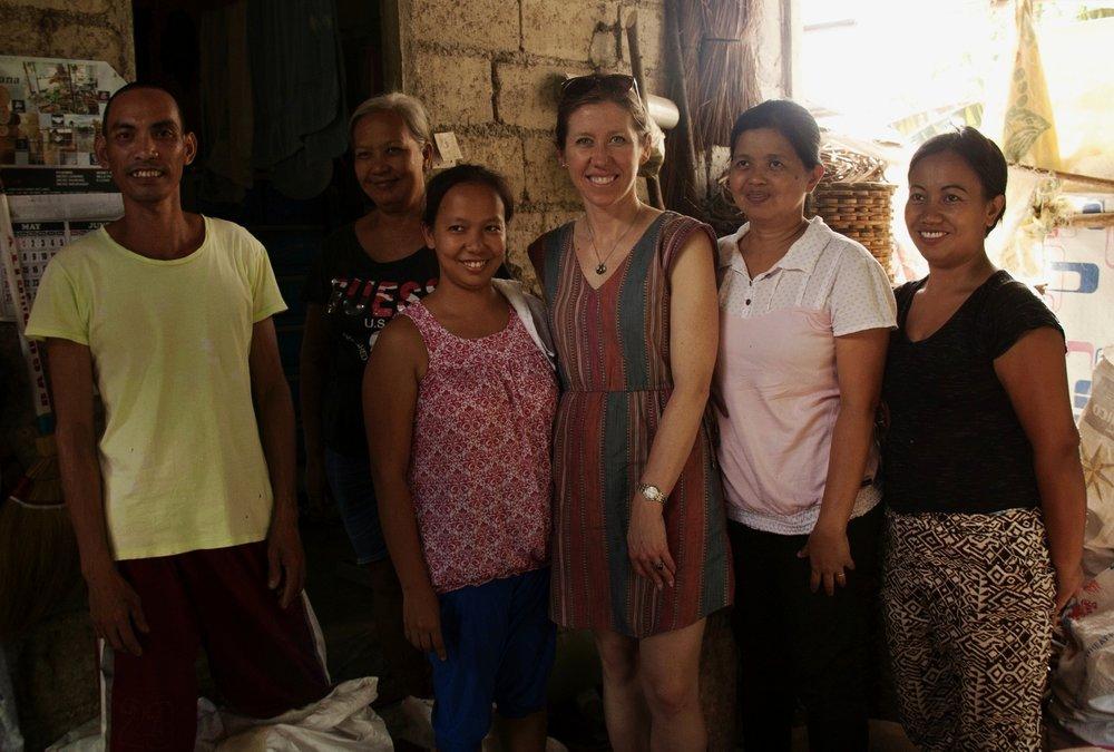 Serrv buyer Liz with artisan family in Quezon, Philippines.