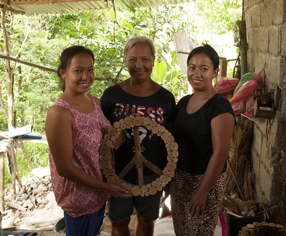 Generations of artisans: Sarita (center) with daughters Agnes (left) and Annalise.