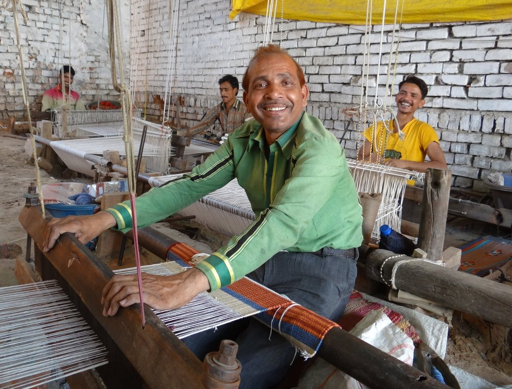In India: Rahees, who works in the city of Agra, is proud of the designs he creates for our handwoven rugs and pillows.